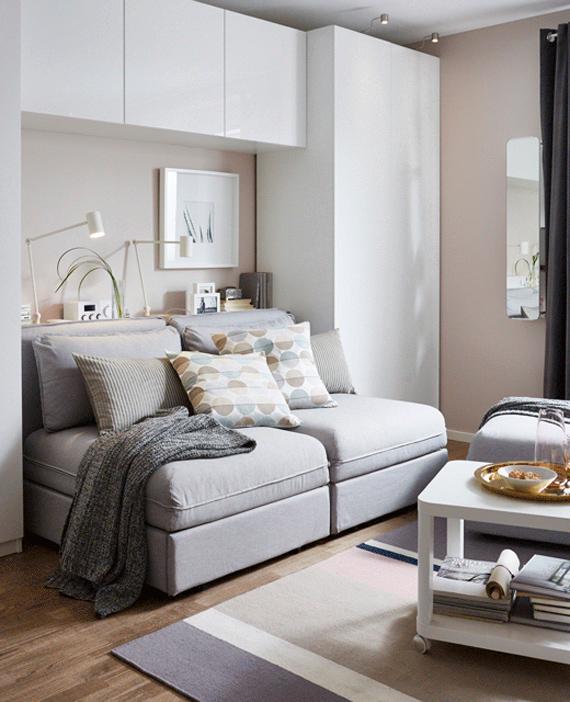 sofa y reposapies con almacenaje