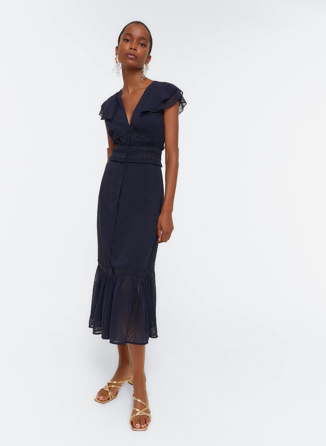 vestido confeccionado en plumeti de color azul marino