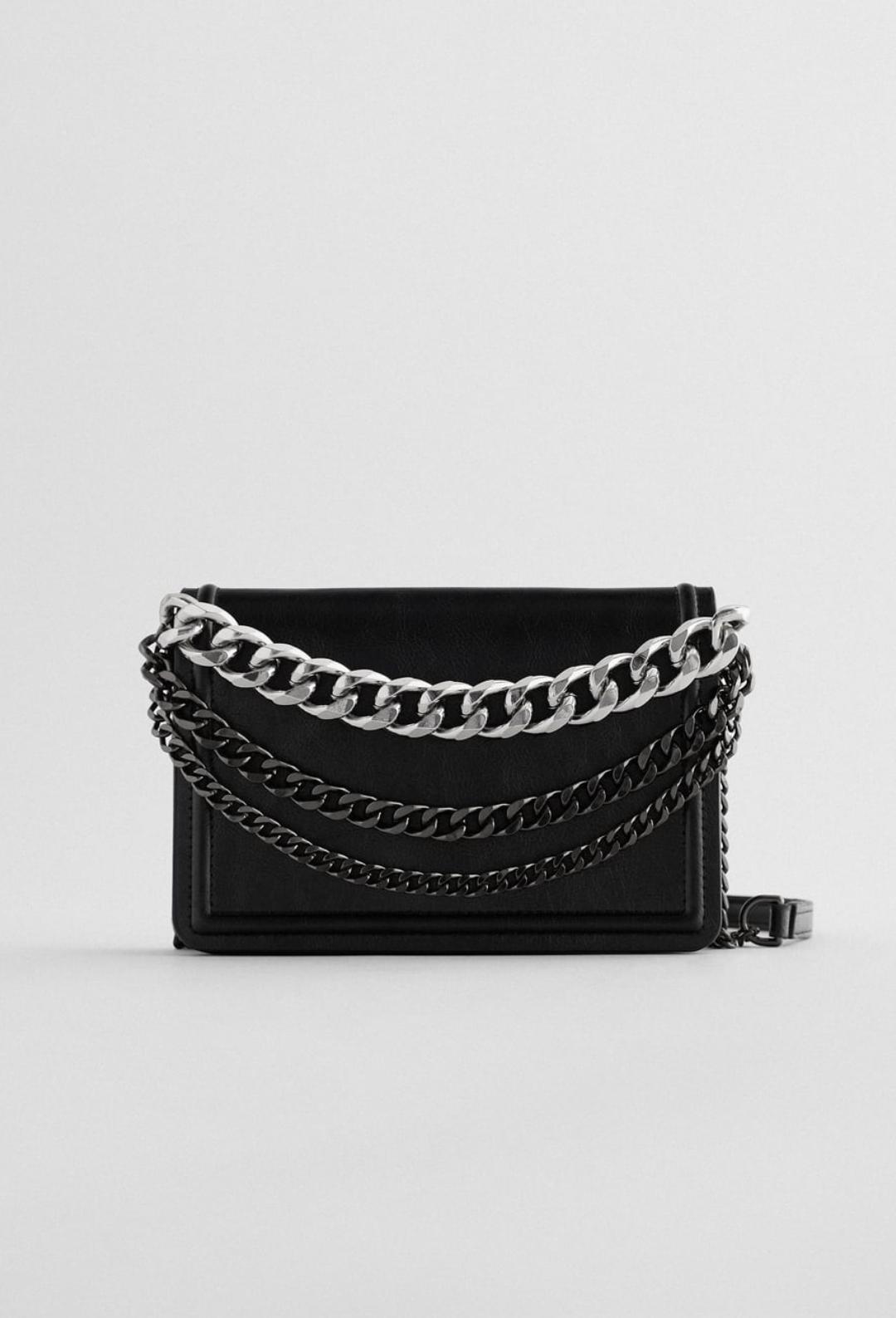 Bandolera de color negro con cadenas combinadas en plata y negro 25'95€
